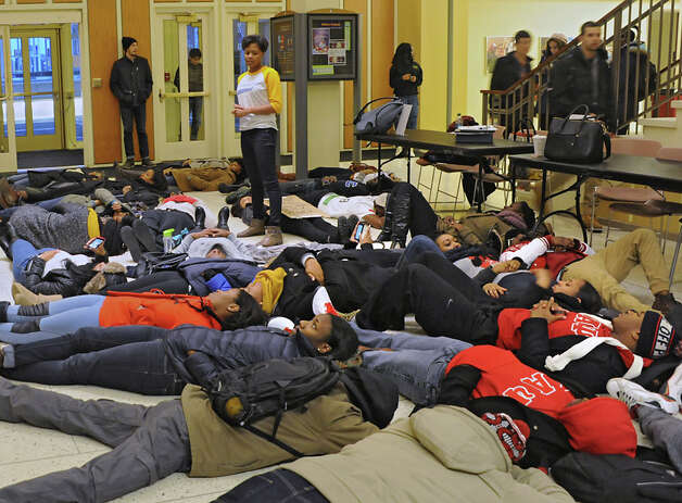 "Senior student Pareese Hankerson of Queens and President of the National Association For the Advancement of Colored People, center, speaks as her organization host a ""die-in"" to honor the lives of Eric Garner and Michael Brown in the campus center at the University of Albany on Monday, Dec. 8, 2014 in Albany, N.Y. The students participating in the protest laid down on the floor for 11 minutes which was the time it took Eric Garner to die when police put him in a chokehold. (Lori Van Buren / Times Union) Photo: Lori Van Buren, Albany Times Union / 00029772A"
