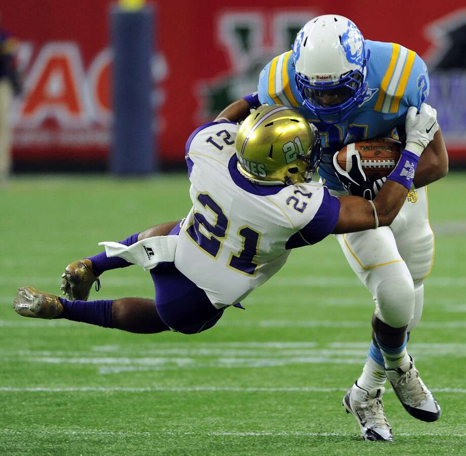 Southern running back Lenard Tillery, right, is tackled by Alcorn State defensive back Quinton Cantue in the first half of the Southwestern Athletic Conference championship NCAA college football game, Saturday, Dec. 6, 2014, in Houston. (AP Photo/Eric Christian Smith)