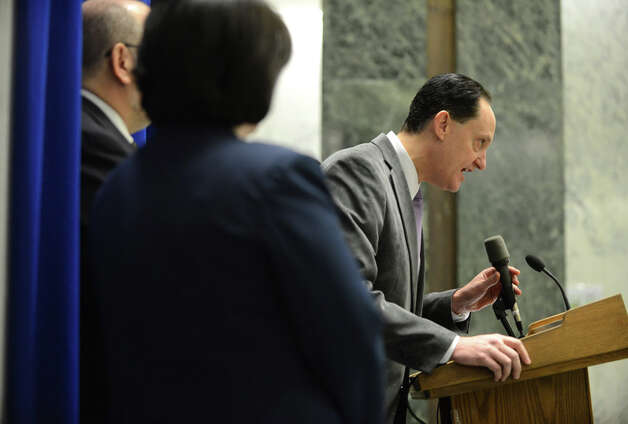 "Brad Rosenstein, proprietor of Jack's Oyster House, speaks during a press conference where restaurant and hospitality trade association leaders advocated to keep the state's current tip credit system in place Monday, Dec. 8, 2014, at the Legislative Building in Albany, N.Y. The New York State Department of Labor Wage Board will hold a public hearing Tuesday to make recommendations to the Department of Labor on whether to keep the current ""tip credit"" system or require employers to pay the minimum wage to all food service workers. Under the current law workers pay plus tips can satisfy minimum wage requirements. (Will Waldron/Times Union) Photo: WW, Albany Times Union / 00029777A"