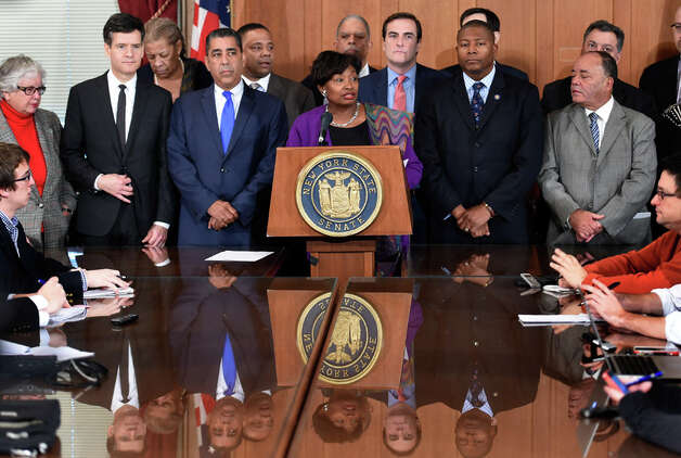 Senator Andrea Stewart-Cousins, center, is surrounded other members of the Democratic Conference who called for reforms in the criminal justice system in response to the alleged death of Eric Garner in police custody Tuesday morning, Dec. 9, 2014, during a press conference at the State Capitol in Albany, N.Y. (Skip Dickstein/Times Union) Photo: SKIP DICKSTEIN, ALBANY TIMES UNION / 00029783A
