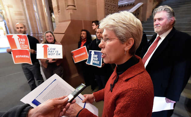 Rev. Paula Gravelle, executive director of the NYS Council of Churches, is joined by other workers' advocates in calling for Gov.  Cuomo to eliminate the sub-minimum wage for New York's tipped workers during a press briefing in the State Capital Tuesday morning, Dec. 9, 2014, in Albany, N.Y.  (Skip Dickstein/Times Union) Photo: SKIP DICKSTEIN, ALBANY TIMES UNION / 00029784A