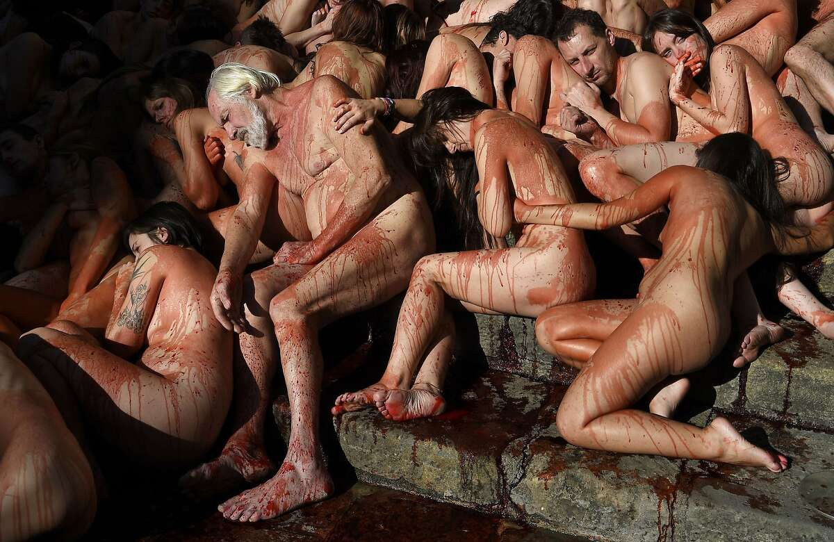 COVERED WITH FAKE BLOOD AND NOTHING ELSE, activists of the animal-rights group AnimaNaturalis gather in a big pile in Barcelona to denounce the use of animal skins in fashion.