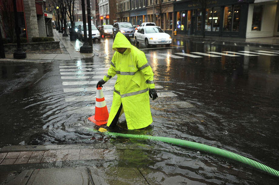 City workers pump water from a flooding intersection at Fairfield Avenue and Lafayette Street as a nor'easter dumped heavy rain in Bridgeport, Conn. on Tuesday, December 9, 2014. Photo: Brian A. Pounds / Connecticut Post
