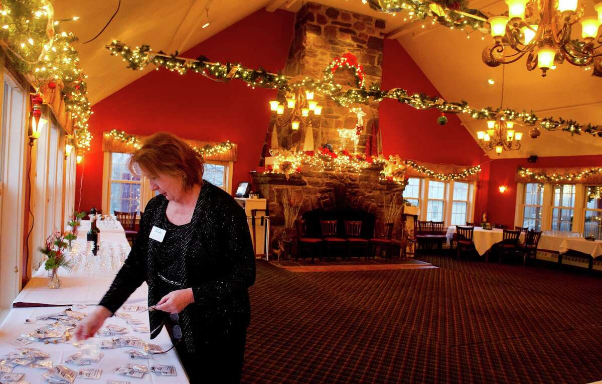 Executive Vice President Barbara Seiter organizes nametags in preparation for the Stamford Chamber of Commerce's annual holiday party at Zody's 19th Hole in Stamford, Conn., on Tuesday, December 9, 2014.