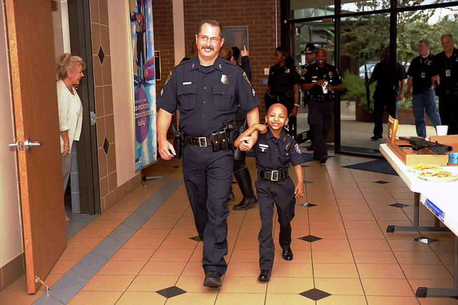 The Houston Police Department has made sure that a six-year-old girl fighting cancer has been able to live out one of her biggest dreams: serving as a Houston cop. Khyrstin Andrews told her mother that she wanted to be a police officer and pull someone over for speeding. She ended up joining both HPD and Texas Department of Public Safety as an honorary member of the force. According to the Facebook page that her mother runs, Kyssi is currently undergoing a particular rough round of chemotherapy to fight a rare form of kidney cancer that she was diagnosed with in early 2012. She has over 185,000 fans on Facebook already cheering her on in the fight. Photo: Houston Police Department