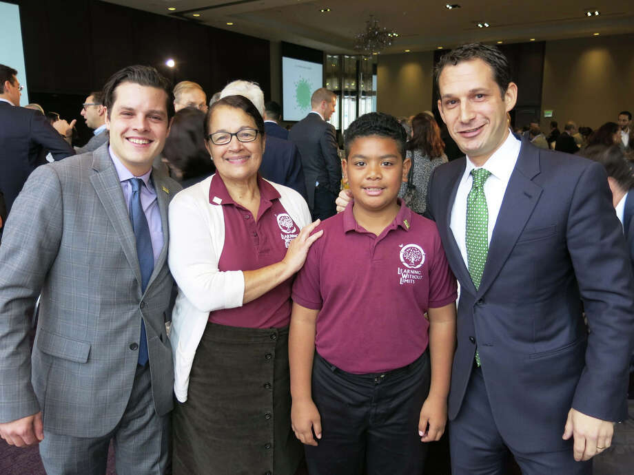 Reading Partners CEO Michael Lombardo (left); Learning Without Limits College Preparatory Academy teacher Emily Rosa and fourth-grader Sione Laulea; Tipping Point CEO Daniel Lurie at the St. Regis. Photo: Catherine Bigelow / Special To The Chronicle / ONLINE_YES