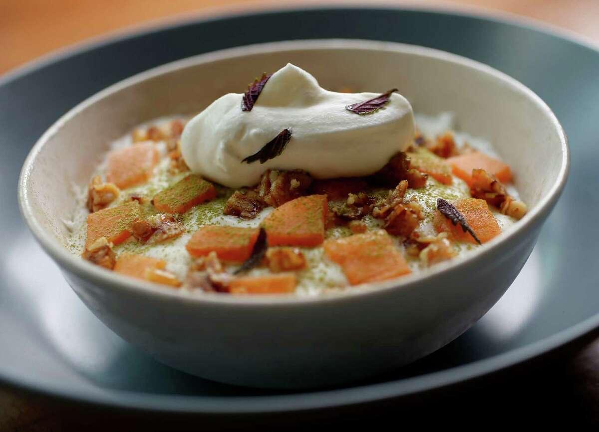 The Goat Milk dessert (vanilla yogurt, persimmon, pine nut granola and matcha) served at Dosi Restaurant and Soju Bar, Wednesday, Dec. 3, 2014, in Houston. ( Karen Warren / Houston Chronicle )