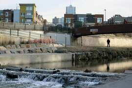 As water gushes through Confluence Park, where Cherry Creek joins the South Platte, a key channel in Colorado's water supply, in Denver, state lawmakers are drawing up a strategy to protect some of the trillions of gallons of water that runs out of the Rocky Mountains every spring as the snow melts, most of which flows into drought-stricken California and other states.