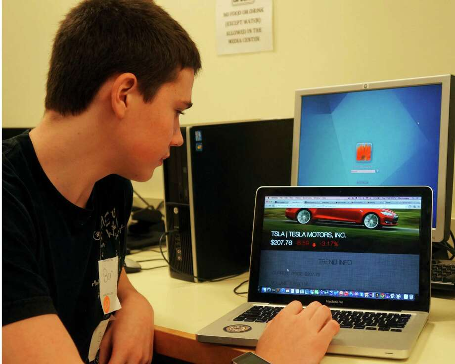 Greenwich High School senior Ben Langley, in his second year studying computer programming at the high school, shows a profile page he made for Tesla Motors. Photo: Paul Schott / Greenwich Time