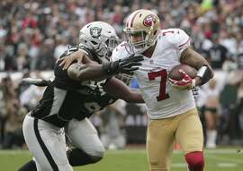 49ers quarterback Colin Kaepernick (7) was bottled up by linebacker Sio Moore (55) and the Raiders' defense.