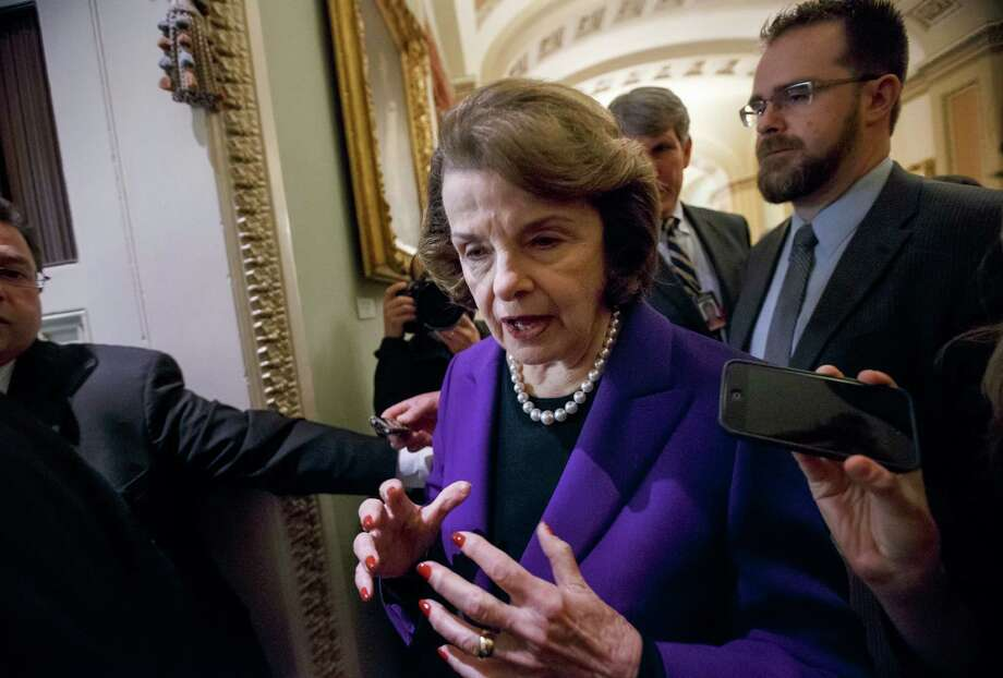 """Sen. Dianne Feinstein, D-Calif., chairwoman of the Senate Intelligence Committee, leaves the chamber after releasing a report on the CIA's harsh interrogation techniques at secret overseas facilities after the 9/11 terror attacks, at the Capitol in Washington, Tuesday, Dec. 9, 2014. Feinstein  branded the findings a """"stain on the nation's history."""" (AP Photo/J. Scott Applewhite) Photo: J. Scott Applewhite / Associated Press / AP"""