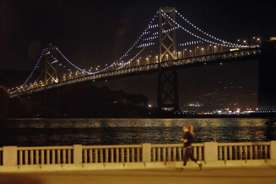"""Artist Leo Villareal tests the """"Bay Lights"""" installation in February 2013. Photo: Carlos Avila Gonzalez / The Chronicle / ONLINE_YES"""