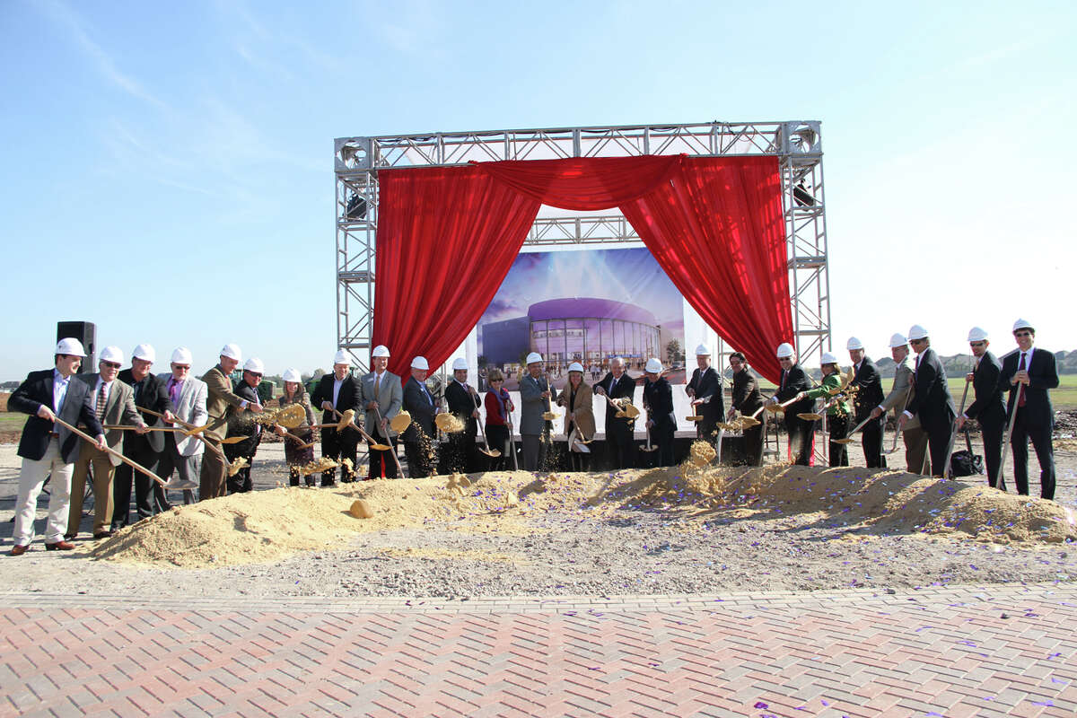 Participating in the groundbreaking are Tommy Cole and Michael Johnson, both of Linbeck Group, LLC; Mike Goodrum and Jim Callaway, both of the City of Sugar Land; David Stueckler and Craig Fredrickson, both of Linbeck Group, LLC; Jennifer May and Christopher Steubing, both of the City of Sugar Land; Joe Zimmerman, Steve Porter, Himesh Gandhi, Bridget Yeung, Harish Jajoo, Amy Mitchell and James Thompson, members of Sugar Land City Council; Allen Becker, David Anderson and Gary Becker, all of ACE Theatrical Group; Allen Bogard, of the City of Sugar Land; Sunni Markowitz, Gary Markowitz and Kirk Feldmann, all of ACE Theatrical Group; Gary Martinez, of Martinez&Johnson Architecture; and Adam Ball and Louis Gurwitch, both of ACE Theatrical Group. Nicolle Walters