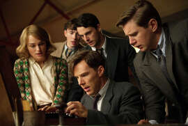 "Keira Knightley (left), Matthew Beard, Matthew Goode, Benedict Cumberbatch (seated) and Allen Leech work on breaking the Nazis' Engima code in ""The Imitation Game."""