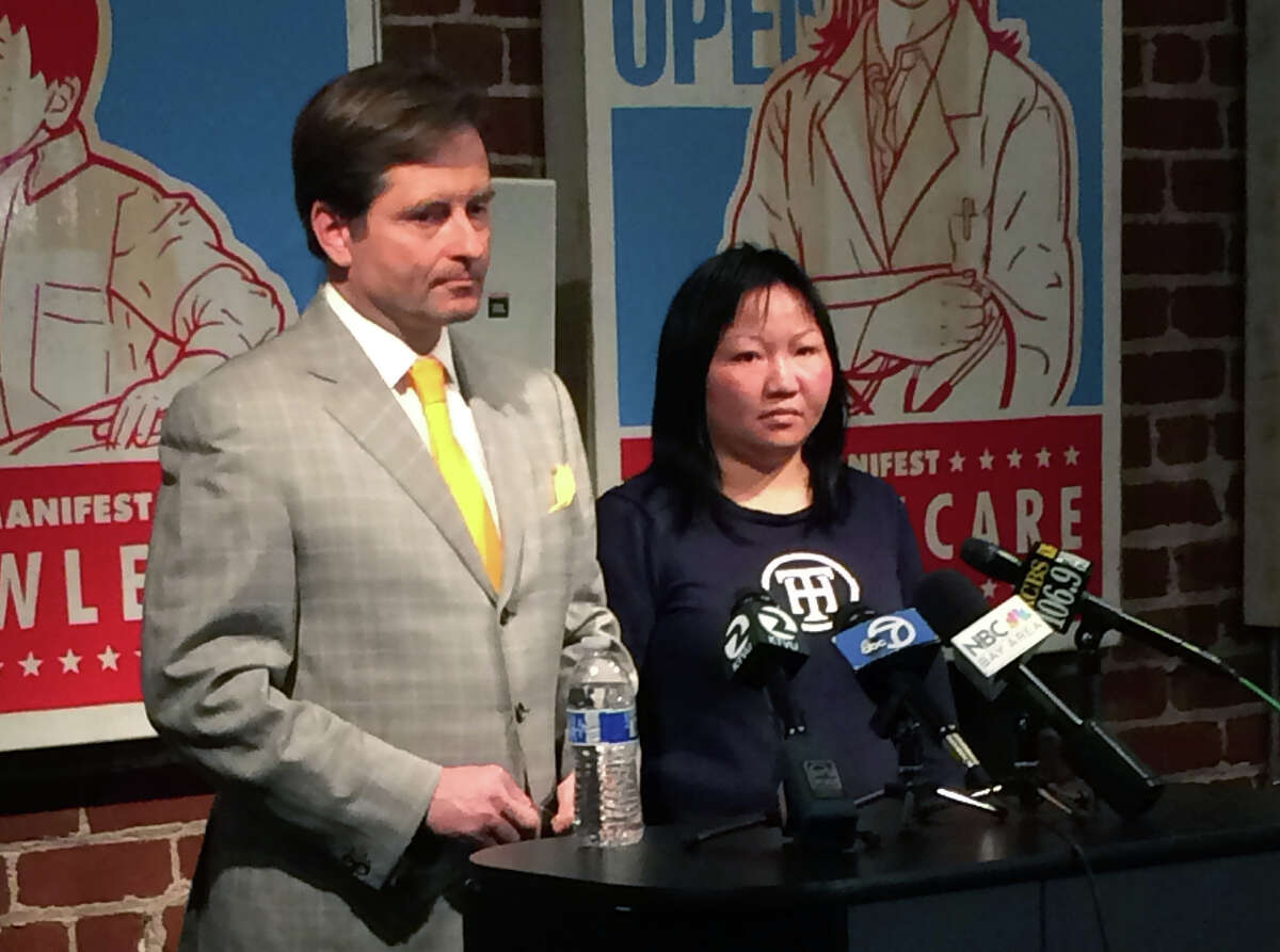 Attorney Christopher Dolan, left, and Huan Kuang address the media during a press conference on December 9, 2014 in San Francisco, California, regarding the sentencing the Uber driver who struck Kuang and her two children, killing her six-year-old daughter, Sofia Liu. The driver, Syed Muzaffar, 57, of Union City, is charged with misdemeanor vehicular manslaughter in connection with the crash.