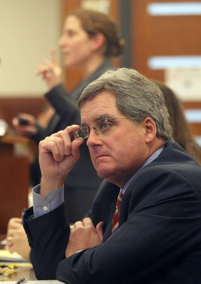 City attorney Dennis Herrera (front) listens as San Francisco deputy city attorney Sara Eisenberg speaks in defense of City College of San Francisco in Superior Court in San Francisco, Calif., on Tuesday, December 9, 2014. Photo: Liz Hafalia, The Chronicle
