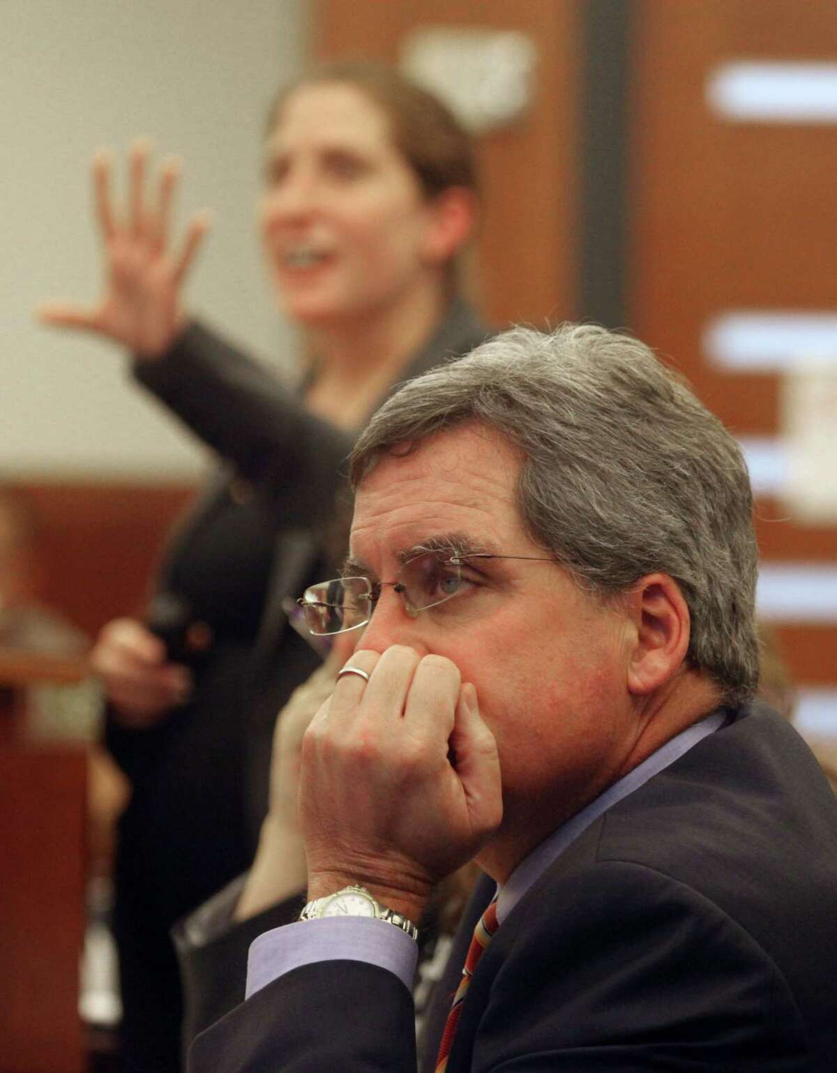 City attorney Dennis Herrera (front) listens as San Francisco deputy city attorney Sara Eisenberg speaks in defense of City College of San Francisco in Superior Court in San Francisco, Calif., on Tuesday, December 9, 2014.