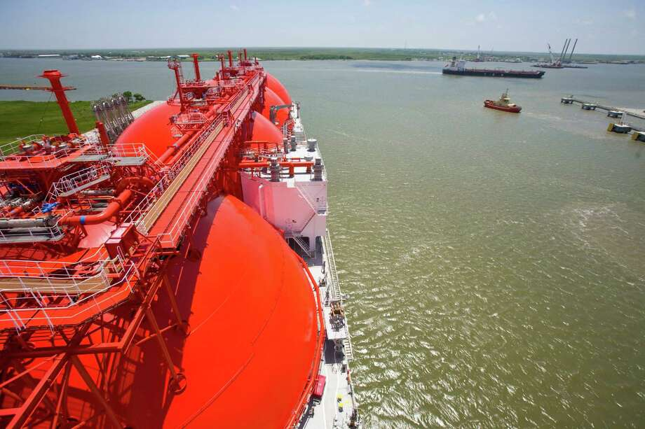 An oil tanker, right, cruises past a new liquefied natural gas tanker at the Cheniere terminal in Cameron Parish, La., May 20, 2008. By 2017, the facility built by Houston-based Cheniere Energy could handle an amount equal to roughly a sixth of the gas that flows from Russia to Europe, part of a new surge of LNG supplies coming not only from the U.S., but also Australia, Africa and the Middle East. (Michael Stravato/The New York Times) Photo: MICHAEL STRAVATO, STR / New York Times / NYTNS
