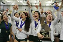 Members of the Sacred Heart Cathedral girls volleyball team celebrate their Division III state title-winning 25-15, 25-19, 25-23 defeat of Saddleback Valley Christian (San Juan Capistrano).