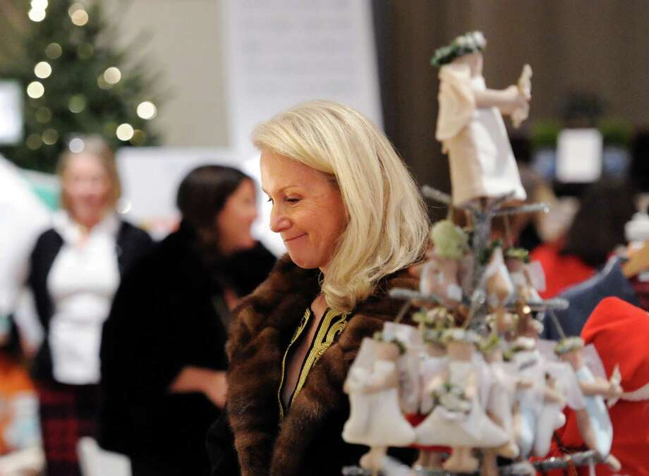 Mary Pat Cabrera of Greenwich smiles while shopping during the Antiquarius Holiday Boutique at Christ Church Greenwich Parish Hall, Tuesday night, Dec. 9, 2014. The Greenwich Historical Society sponsors the event that will also be held on Wednesday, Dec. 10, from 9 a.m. to 6 p.m. at Christ Church Greenwich. Photo: Bob Luckey / Greenwich Time