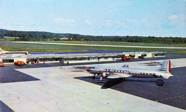 A postcard of the Albany County Airport from the late 1960's is one of 250,000 postcards in deltiologist Robert Drew's collection Friday Dec. 5, 2014, in Albany, NY. (John Carl D'Annibale / Times Union) Photo: John Carl D'Annibale / 00029763A