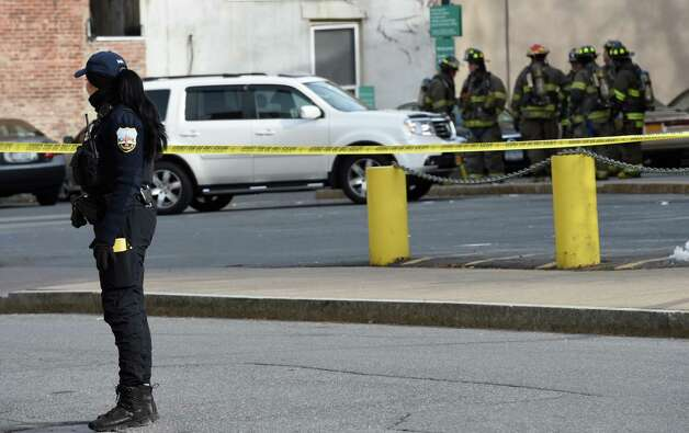 A police officer keeps traffic from Clinton Street Monday afternoon, Dec. 8, 2014, after a report of a man hole explosion in Schenectady, N.Y.     (Skip Dickstein/Times Union) Photo: SKIP DICKSTEIN