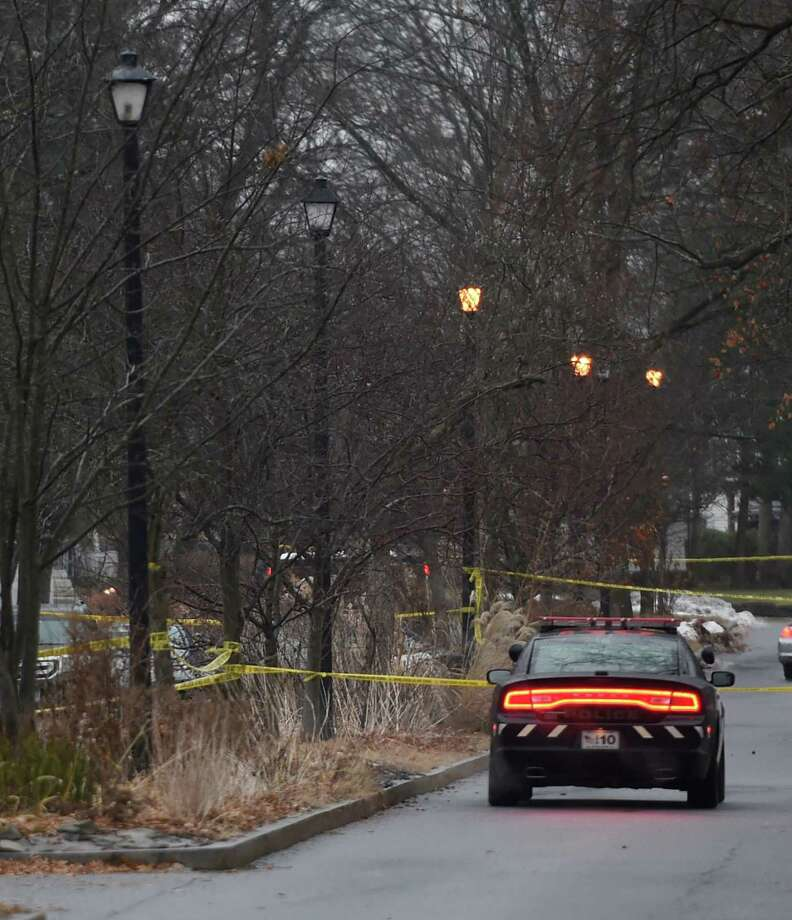 A police cruiser secures the scene of a shooting on Parkwood Boulevard Tuesday morning Dec. 9, 2014 in Schenectady, N.Y.     (Skip Dickstein/Times Union) Photo: SKIP DICKSTEIN