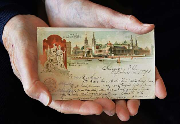 Robert Drew, a deltiologist or postcard collector, holds his oldest postcard from the World's Columbian Exposition in Chicago from 1893, Friday Dec. 5, 2014, in Albany, NY. (John Carl D'Annibale / Times Union) Photo: John Carl D'Annibale / 00029763A