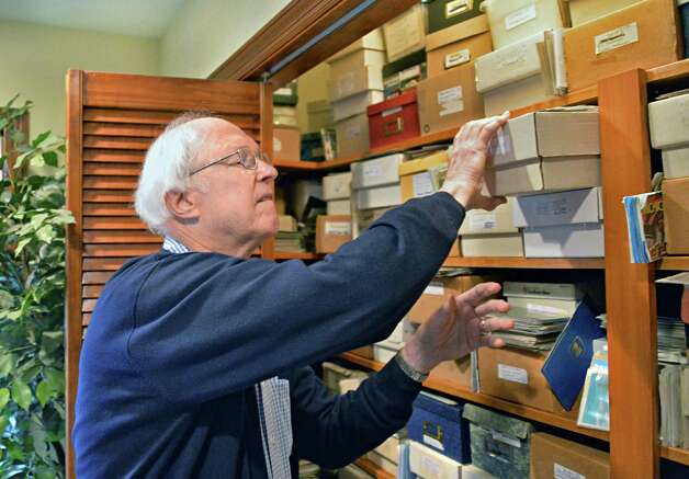 Robert Drew, a deltiologist or postcard collector, pulls cards from one of two closets that house his collection of more than 250,000 postcards at his home Friday Dec. 5, 2014, in Albany, NY. (John Carl D'Annibale / Times Union) Photo: John Carl D'Annibale / 00029763A