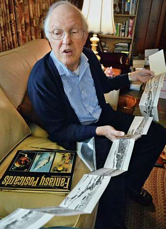 Robert Drew, a deltiologist or postcard collector, holds a panoramic fold-out postcard from his extensive  collection Friday Dec. 5, 2014, in Albany, NY. (John Carl D'Annibale / Times Union) Photo: John Carl D'Annibale / 00029763A