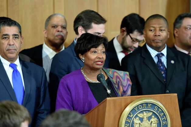 Senator Andrea Stewart-Cousins, center, is surrounded other members of the Democratic Conference who called for reforms in the criminal justice system in response to the alleged death of Eric Garner in police custody Tuesday morning, Dec. 9, 2014, during a press conference at the State Capitol in Albany, N.Y. (Skip Dickstein/Times Union) Photo: SKIP DICKSTEIN / 00029783A
