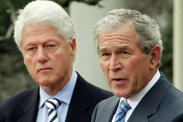 In this Jan. 16, 2010, file photo, former President Bill Clinton listens to former President George W. Bush speak in the Rose Garden of the White House in Washington. President Barack Obama asked Bush and Clinton to help with U.S. relief efforts after the earthquake in Haiti. They have dominated American politics for the past three decades: the Bush and Clinton families, taking turns in a string of positions of power and influence. The dedication of George W. Bush's presidential library on Thursday shines a spotlight on two of the nation's most prominent political dynasties _ and the prospect of another White House campaign, in 2016, featuring the families.  (AP Photo/Ron Edmonds, File)