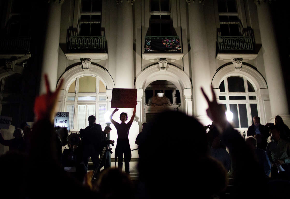 Protesters gather at City Hall in Berkeley after the City Council meeting was canceled.