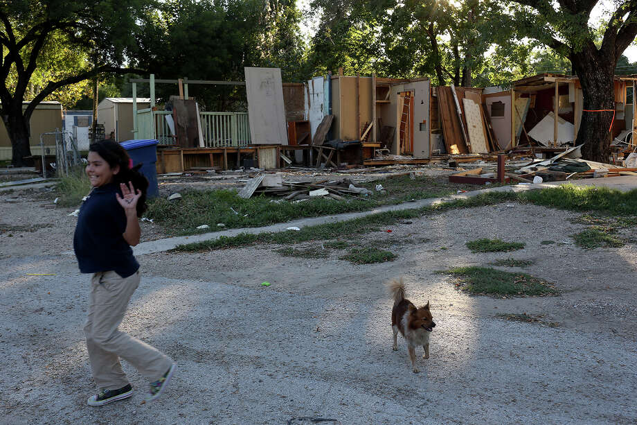 Valeria Araujo, 7, runs by the remains of an addition to a trailer that was removed at the Mission Trails Mobile Home Park in San Antonio. Low-income residents at the park were displaced by gentrification. Photo: Lisa Krantz / Lisa Krantz / San Antonio Express-News / SAN ANTONIO EXPRESS-NEWS