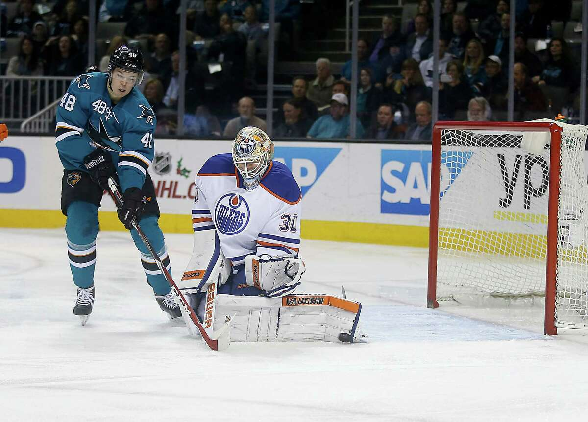 Edmonton Oilers goalie Ben Scrivens (30) stops a shot from San Jose Sharks center Tomas Hertl (48) during the first period of an NHL hockey game Tuesday, Dec. 9, 2014, in San Jose, Calif. (AP Photo/Tony Avelar)