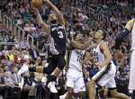 San Antonio Spurs' Marco Belinelli (3) goes to the basket as Utah Jazz's Alec Burks (10) and Rudy Gobert (27) defend in the second quarter during an NBA basketball game Tuesday, Dec. 9, 2014, in Salt Lake City.  (AP Photo/Rick Bowmer)