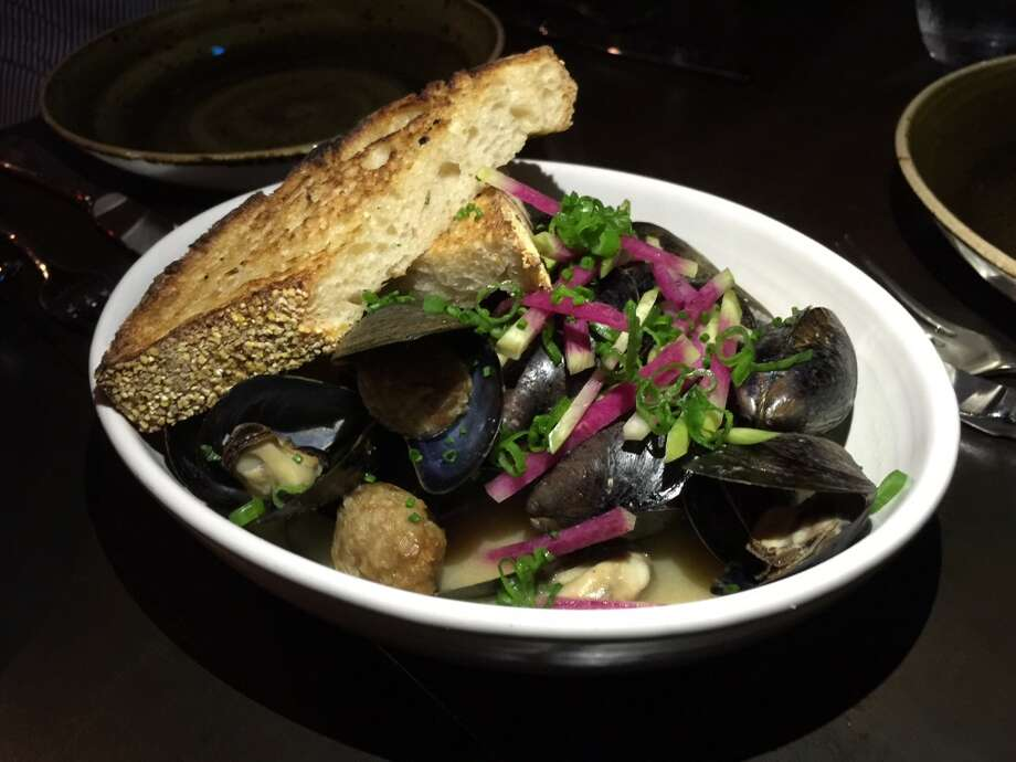 Oso, Sonoma: Mussels baked in a miso broth with ginger-scented chicken meatballs, shaved radishes and green onions ($14). The stock has a strong chicken flavor that melds with the seafood.