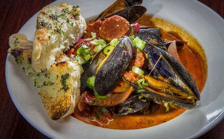 ... restaurant steams mussels in a spicy tomato sauce with chorizo an