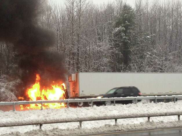 The cab of a tractor trailer burns on the southbound side of the Northway on Wednesday, Dec. 10, 2014. The fire is causing a massive traffic jam and the state is preparing to close the southbound side south of Exit 8. (Azra Haqqie / Times Union)