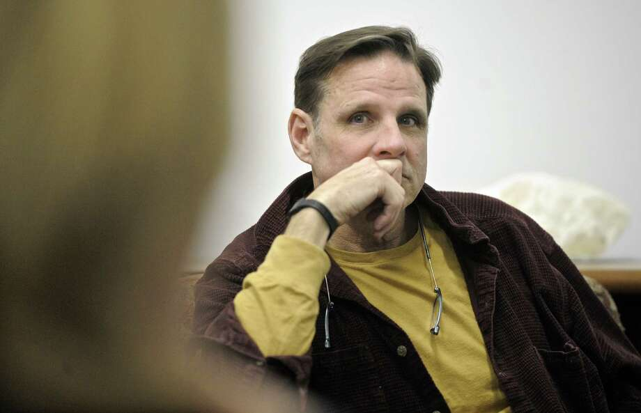 Bill Schroeder, one of the founders of Bethel Arts, listens to another member during a meeting at Bethel Arts space on Greenwood Avenue, in  downtown Bethel, on Tuesday, December 9, 2014, in Bethel, Conn. Photo: H John Voorhees III / The News-Times