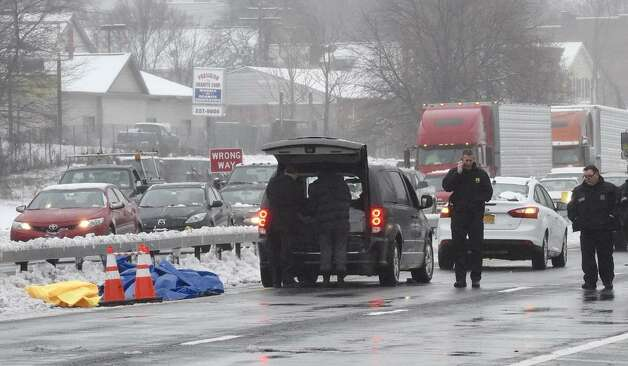 Authorities remain at the scene of a fatal crash that killed a woman in her early 50s on Wednesday, Dec. 10, 2014. (Skip Dickstein / Times Union)