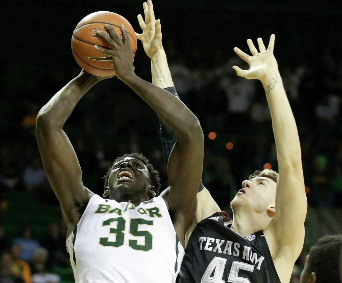 Baylor forward Johnathan Motley (35) goes up for a shot as Texas A&M 's Dylan Johns (45) of England defends in the second half of an NCAA college basketball game, Tuesday, Dec. 9, 2014, in Waco, Texas. (AP Photo/Tony Gutierrez)