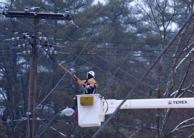 A National Grid crew works to repair a power outage in Saratoga Springs on Wednesday, Dec. 11, 2014. (Skip Dickstein / Times Union)