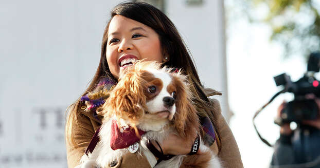 Nina Pham holds her dog Bentley, at Hensley Field in Grand Prairie, Texas, Nov. 1, 2014. Pham, who recovered from Ebola, and the King Charles Spaniel were reunited privately on Saturday in a vacant residence where officers once lived at a decommissioned naval air base, where he was quarantined for 21 days. (AP Photo/The Fort Worth Star-Telegram, Juan Guajardo)  MAGS OUT; (FORT WORTH WEEKLY, 360 WEST); INTERNET OUT Photo: Juan Guajardo, Associated Press / The Fort Worth Star-Telegram