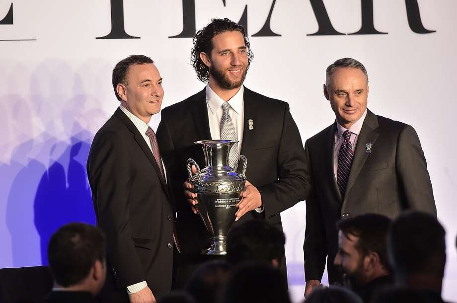 Paul Fichtenbaum, Madison Bumgarner and Rob Manfred attend the Sportsman Of The Year 2014 Ceremony. Photo: Michael Loccisano, Getty Images