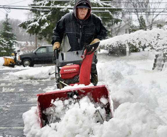 Mike Grillo snow blows at Reach Out Fellowship Church Wednesday Dec. 10, 2014, in Colonie, NY.  (John Carl D'Annibale / Times Union) Photo: John Carl D'Annibale / 00029805A