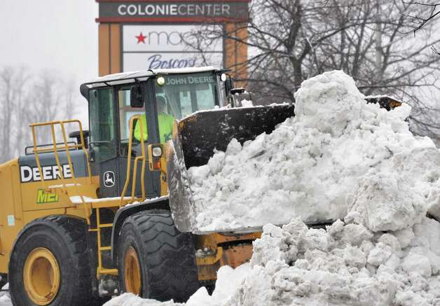 Heavy equipment clears snow at Colonie Center Wednesday Dec. 10, 2014, in Colonie, NY.  (John Carl D'Annibale / Times Union) Photo: John Carl D'Annibale / 00029805A