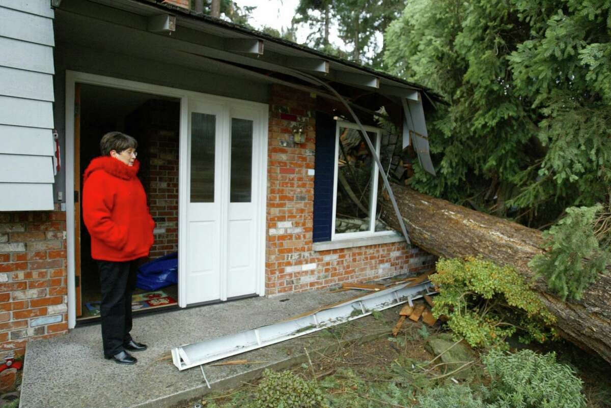 Thursday's storm could rival the Hanukkah eve storm of 2006, which caused serious damage across the Puget Sound region and left tens of thousands of people without power. Here's a look back at the impact of that storm.First, Carole Schuehle stands outside her Newport Hills home on December 15, 2006, after a tree that came through her living room during the previous night's wind storm. Thinking that something like this could happen, she and her husband went to stay at a hotel.
