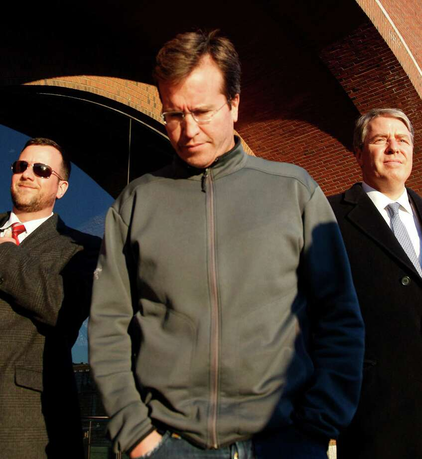 Former Stamford-based hedge fund portfolio manager Todd Newman, of Needham, Mass., leaves the federal court house after his appearance in connection with an insider trading investigation in Boston in this file photo. The 2nd U.S. Circuit Court of Appeals overturned the convictions of Newman and Anthony Chiasson, finding they were too far removed from inside information to be held responsible for it. (AP Photo/Charles Krupa) Photo: Charles Krupa, Associated Press / Associated Press contributed