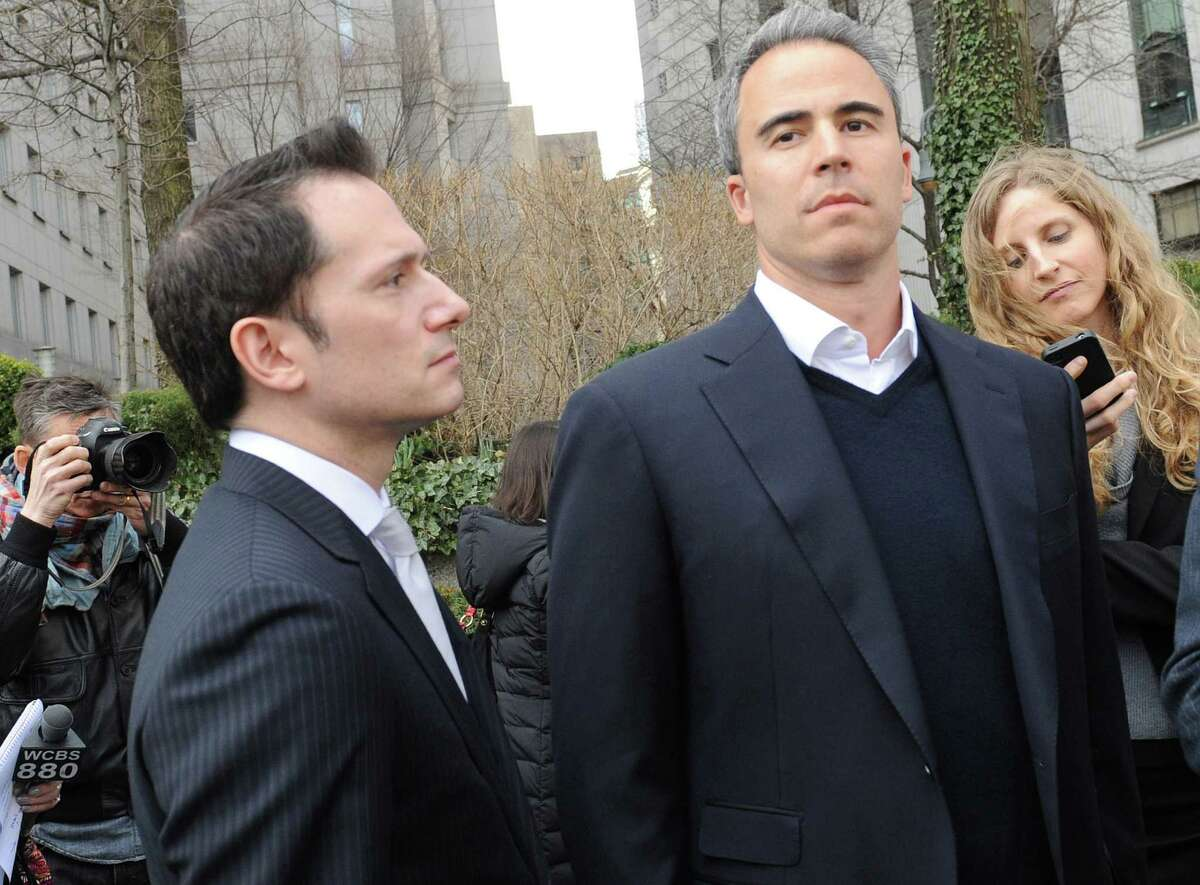 In this file photo, Michael Steinberg, second from right, exits Manhattan federal court. The conviction reversals could jeopardize the insider trading conviction of former Stamford-based SAC Capital portfolio manager Michael Steinberg, which is being challenged on the same principle. (AP Photo/Louis Lanzano, File)